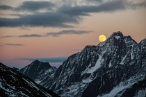 The moon rises over the Austrian Alps in Tirol