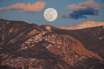 The Moon rising over the Sangre de Cristo Mountains