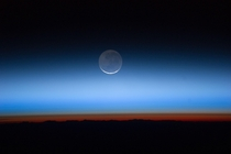 The Moon Seen from the International Space Station -- the limb of Earth is near the bottom transitioning into the orange-colored troposphere