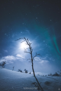 The moon stars and northern lights in the snow Finnish Lapland  IG Tidewarp