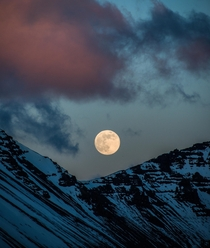 The moonrise above a summit in Iceland while the clouds are red from the sunset in the other direction  - more of my landscape at insta glacionaut