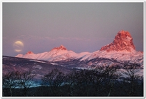 The moonset over Chief Ninaki and Papoose in NW Montana on a cold February morning