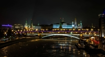 The Moscow Kremlin and Bolshoy Kamenny bridge at night