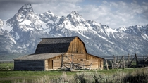 The Moulton Barn an abandoned barn in Mormon Row in Grand Teton National Park Wyoming  by Erik de Klerck
