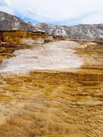 The Mound Spring of Mammoth Hot Springs in Yellowstone National Park The terraces are created by the build-up of mineral deposits and calcium carbonate over thousands of years
