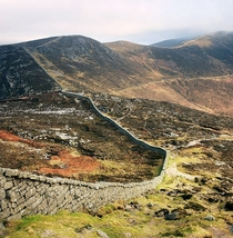 The Mourne Wall Ireland - m x m  kilometers long tops  mountain peaks took  years to build - - built to stop sheep peeing in reservoir Doesnt