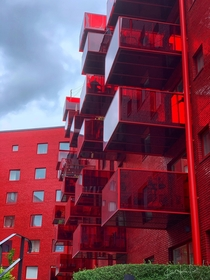 The Muddus neighborhood in Stockholm Sweden stands out through its large jumping balconies and its faade cladding of clear red glazed brick Architect Wingrdh