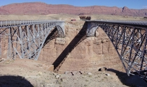 The  Navajo Bridge at left and the  Navajo Bridge at right across the Colorado River at Marble Canyon The Echo Cliffs are in the background to the east