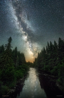 The night sky above the Connecticut River in Pittsburg New Hampshire