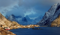 The Norwegian village of Reine as the sun is coming up in the morning