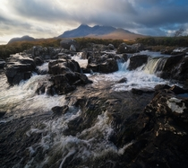 The numerous cascades around Sligachan looking towards the epic Black Cuillins Isle of Skye Scotland UK