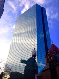 The October Sky reflecting in the John Hancock Tower in Boston MA