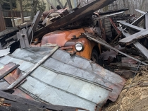 The old barn finally collapsed on the old chevy