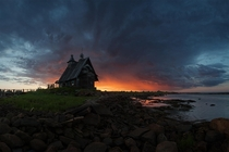 The old church on the coast of White sea in Russia Photo by Sergey Ershov