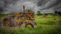 The old yellow tractor  by Brad MacDuff
