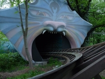 The opening to an abandoned roller-coaster tunnel at Spreepark Berlin