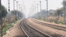 The Overhead catenary wires of the Delhi - Rewari section of Indian railways was recently upgraded to a height of m ft to allow double stack freight trains to pass through