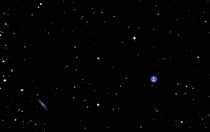 The Owl Nebula M and barred spiral galaxy M
