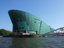 The oxidized copper-clad iconic house of NEMO was designed by Italian architect Renzo Piano to resemble a ship at anchor in the middle of the old port in Amsterdam