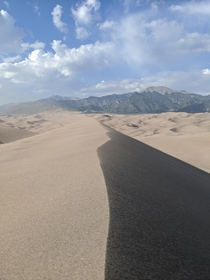 The Pain of the sand stinging my legs in the wind was worth it Star Dune Great Sand Dunes CO