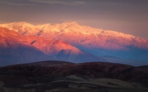 The Panamint Range catching the first light over Death Valley CA