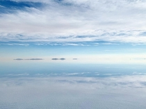 The perfectly reflective salt flat in Uyuni Bolivia makes it look like theres no horizon  x
