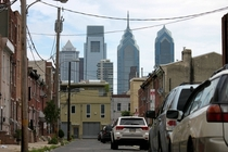 The Philadelphia skyline towering over the row homes of South Philly