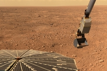 The Phoenix lander scoops up some Martian soil
