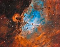 The pillars of creation surrounded by the eagle