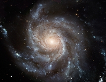 The Pinwheel Galaxy - this giant disk of stars dust and gas is  light-years across nearly twice the diameter of the Milky Way It is estimated to contain at least one trillion stars approximately  billion of which could be like our Sun in terms of temperat