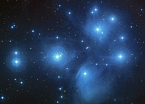 The Pleiades also known as the Seven Sisters is a neighboring star cluster located  ly away in the constellation Taurus It can be easily seen with the naked eye and has an apparent magnitude of  The open cluster consists of approx  luminous blue stars