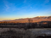 The Presidential Range and Franconia Notch in Alpenglow with a Full Moon Sugar Hill NH