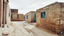 The Pueblo de Acoma NM - a village that was founded in  AD on top of a Mesa  feet high Only  people live here year-round and there is no running water or electricity