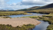 The quaint and elegant river Muick in the Cairngorms National Park Scotland