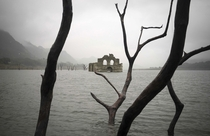 The remains of a mid-th century church known as the Temple of Santiago or the Temple of Quechula The temple was submerged in  when the Nezahualcoyotl dam was built David von Blohn