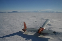 The remains of the Pegasus lie abandoned in McMurdo Sound Antarctica slowly being swallowed by the ice