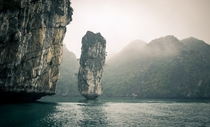 The resilient beautiful longstanding lone rock of Ha Long Bay Vietnam