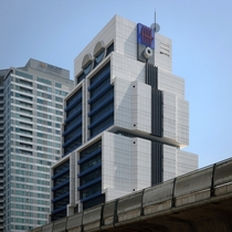 The Robot Building - headquarters of United Overseas Bank in Bangkok Thailand - by Sumet Jumsai