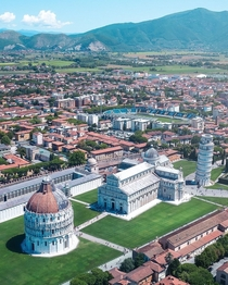 The Romanesque Baptistery Leaning Tower and the Cathedral all gathered in the Piazza dei Miracoli of Pisa Tuscany Italy