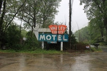 The rotting sign of a long abandoned motel