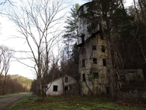 The Roundhouse is a strange abandoned location in my neck of the woods The structure began its life as a storage silo that held pulverized slate particles for the Tennessee Rock Products Company An eccentric local physician sought to transform it into a b