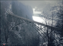 The Ruinacci Bridge Near Camedo Switzerland  Photographed by Saxuisse
