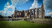 The ruined th-century Augustinian monastery Bolton Priory at Bolton Abbey England Designed and built by the Augustinian Order