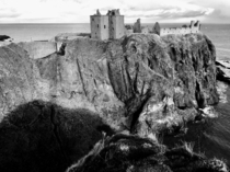 The ruins of Dunnottar Castle in Scotland perched on the edge of the North Sea