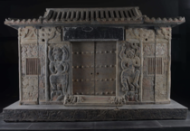 The sarcophagus of Wirkak an -year-old Sogdian caravan leader  CE This Iranian culture was among the most important merchant societies on the Silk Road The tomb imitates Chinese domestic architecture and the epitaph is bilingual Studded doors are flanked