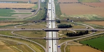 The Schkeuditzer Kreuz was the first of many cloverleafs in Germany opening in  It forms the Junction between Autobahns  and  and was the first freeway interchange in Europe In  it was modified with a flyover ramp
