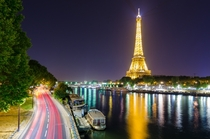 The Seine and Eiffel Tower after dark - Paris France