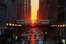 The setting sun is visible down the streets of Chicago during the spring equinox