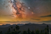The shimmering light of the Milky Way rising high above the Adirondack Mountains on a cool hazy night