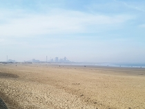 The silhouette of the abandoned Redcar Steelworks peaking through the sea mist